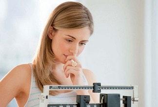 Вес женщины в возрасте 30–35 лет